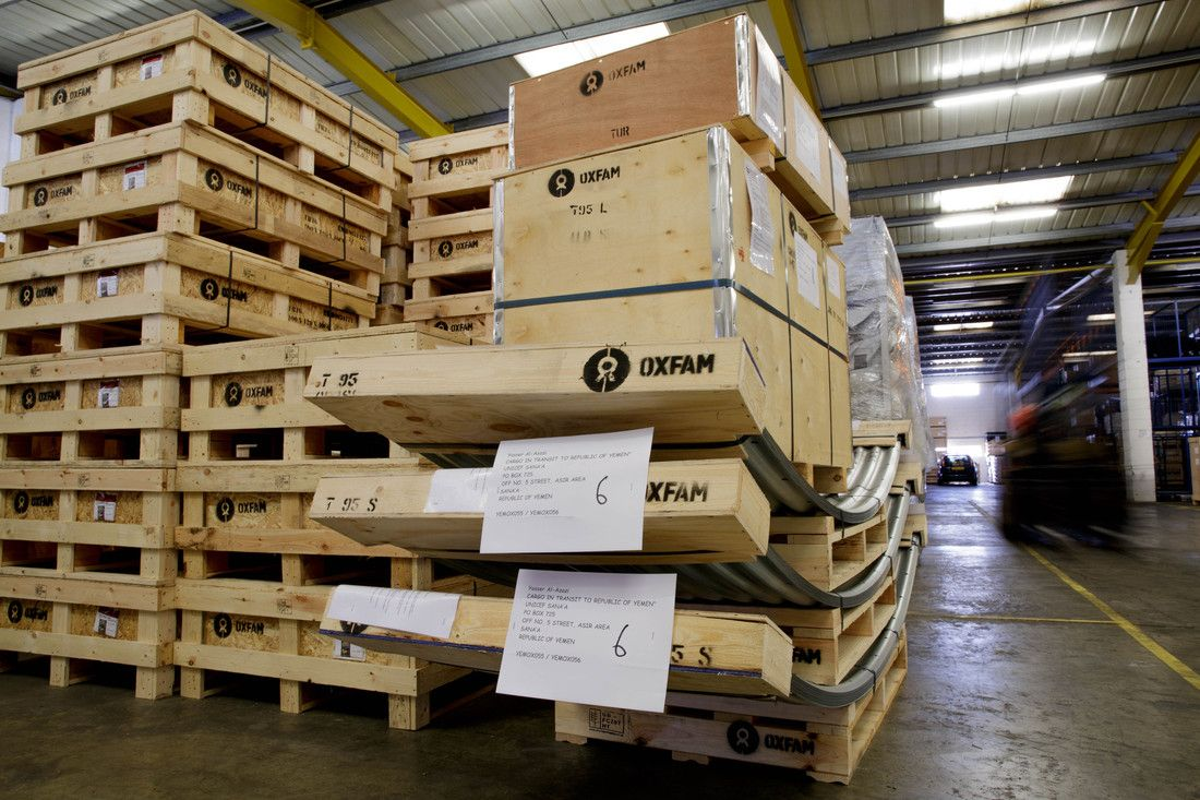 Oxfam staff load 18 tons of critical water equipment to be delivered to beneficiaries in Yemen.